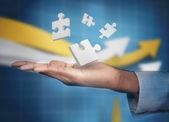 Hand met digitale wit puzzels zwevende — Stockfoto