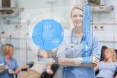 Smiling nurse standing behind blue ECG display screen — Stock Photo