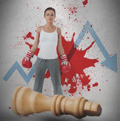 Female boxer against loss arrow and blood spatter with fallen chess piece — Stock Photo