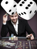 Handsome gambler with digital dice — Stock Photo
