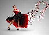 Smiling flamenco dancer with heart shaped paint splatter coming from dress — Stock Photo