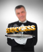 Waiter offering success — Stock Photo
