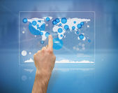 Hand pointing a futuristic screen with the world map — Stock Photo