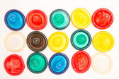 Many different coloured condoms — Stock Photo