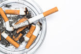 Overhead of burning cigarette in ashtray with copy space — Stock Photo