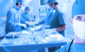 Portrait of a doctor standing in operating room — Stock Photo