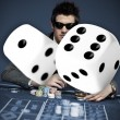 Man wearing sun glasses at roulette table — Stock Photo