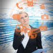 Businesswoman considering various applications and holding tablet - Foto de Stock