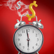 Smoking hot alarm clock with dollar signs — Stock Photo