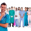 Stock Photo: Happy surgeon with medical staff behind him