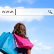 Girl holding shopping bags with address bar above — Stock Photo