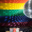 Blocks spelling out gay pride under light of disco ball - Stock Photo