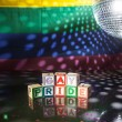Block spelling gay pride under light of disco ball — Stock Photo