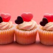 Three valentines cupcakes in a row — Stock Photo #24061293
