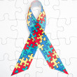 Awareness ribbon for autism and aspergers — Stock Photo