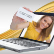 Woman reaching out from laptop showing business card - Stock Photo