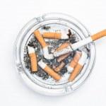Overhead of burning cigarette in ashtray — Stock Photo