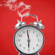 Smoking hot alarm clock - Stock Photo