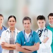 Smiling hospital workers standing in line — Stock Photo