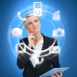 Businesswoman with tablet pc considering various applications - Stock Photo