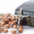 Stock Photo: Black leather bound holy bible with rosary beads