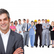 Smiling businessman ahead a group of with different jobs — Stock Photo