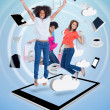 Three cute women jumping on a tablet pc — Stock Photo