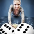 Stock Photo: Blonde womgrabbing chips with digital dice