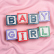 Baby girl spelled out in blocks — Stock Photo