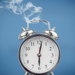 Smoking alarm clock - Stock Photo