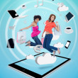 Two cute women jumping on a tablet pc — Stock Photo