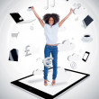 Cheerful woman jumping on a tablet pc — Stock Photo