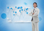 Businessman standing against a digital world map — Stock Photo