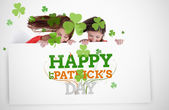 Girls holding placard with st patricks day greeting — Stok fotoğraf