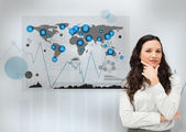 Businesswoman standing with a digital world map — Stock Photo