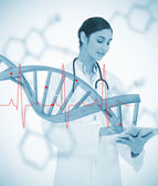 Doctor using tablet pc with graphic dna helix and ECG line — Stock Photo