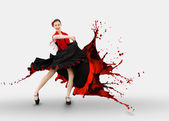 Flamenco dancer with dress turning into paint splashing — Stock Photo