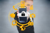 Businesswoman holding up locked smart phone with orange applications — Stock Photo