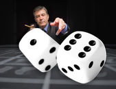 Gambler at the poker table with digital dice in foreground — Stock Photo