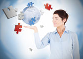 Cheerful woman with puzzles levitating — Stock Photo