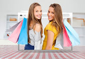 Digital internet window showing girls with shopping bags — Stock Photo