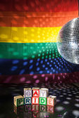 Blocks spelling out gay pride under light of disco ball — 图库照片