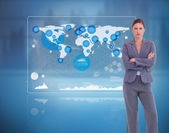 Businesswoman standing against a futuristic screen — Stock Photo