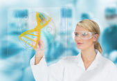 Doctor consulting DNA helix diagram on touchscreen display — Stock Photo