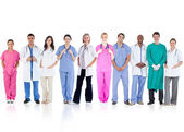 Happy team of doctors standing together in a line — Stok fotoğraf