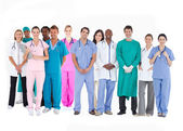 Smiling medical team of doctors nurses and surgeons — Stok fotoğraf
