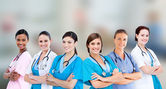 Female hospital workers standing arms folded — Stock Photo