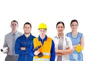 Group of with different jobs standing arms folded — Stock Photo