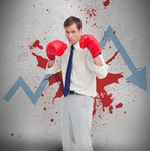 Businessman in boxing gloves against loss arrow and blood spatter — Stock Photo