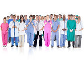 Happy team of smiling doctors standing together — Stok fotoğraf